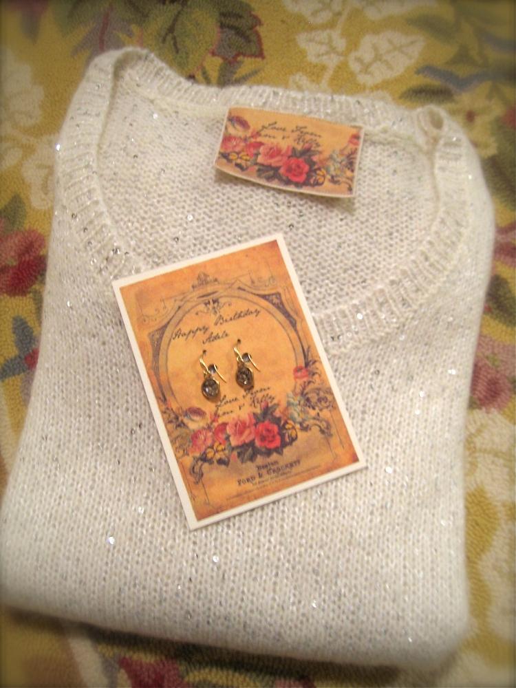 Custom Earring and sweater via Boomdeeadda