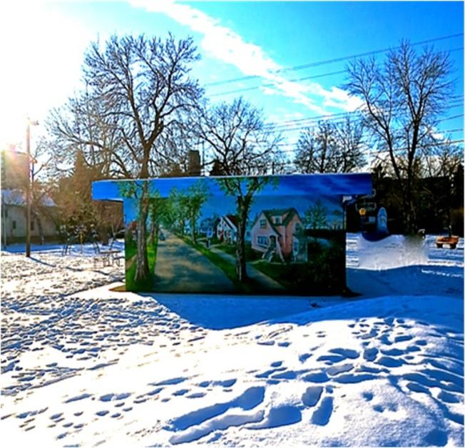 Kris's beautiful mural decorates the community building at Kitchener Park in Edmonton
